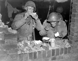 Men of the 102d Infantry Division celebrate Thanksgiving on German soil in 1944