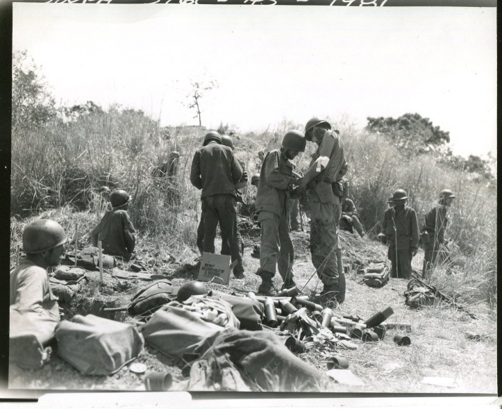 Medics taking care of the wounded during the last attack on Mt. Tanuan (Photo courtesy NARA)