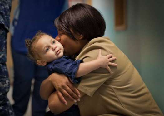 JON M. FLETCHER/The Times-Union Kimora McDonald, 23 months, gets a goodbye hug and kiss from her mother, Petty Officer 1st Class Tomeka McDonald, a Navy counselor, at the Child Development Center, an on-base day care at Jacksonville Naval Air Station.