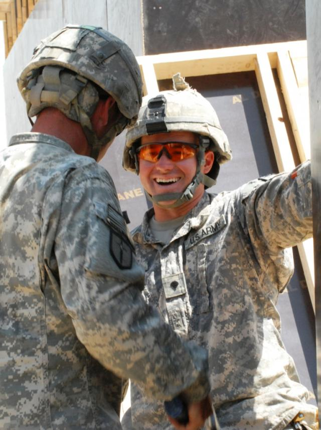 Spc. Jason Rhodes laughes with a fellow Company B, 46th Engineer Combat Battalion (Heavy) / U.S. Army Photo by Sgt. Rebekah Malone