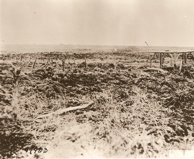 View of damage done by shell fire directed on a gun position used by the 103rd F.A. Near Rambucourt, France. June 24, 1918