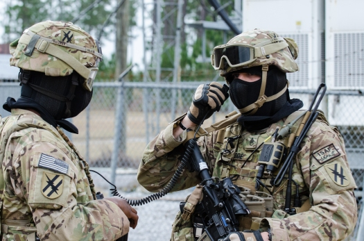 U.S._Army_Staff_Sgt._Robert_Mode,_right,_with_the_48th_Infantry_Brigade_Combat_Team,_Georgia_Army_National_Guard,_coordinates_radio_traffic_for_a_key_leader_engagement_at_the_Camp_Shelby_Joint_Forces_Training_1312