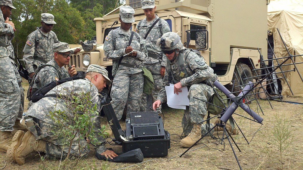 cover photo of soldiers with communications equipment